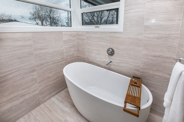 Stylish modern soaker tub, standard in 235 Carleton Avenue.