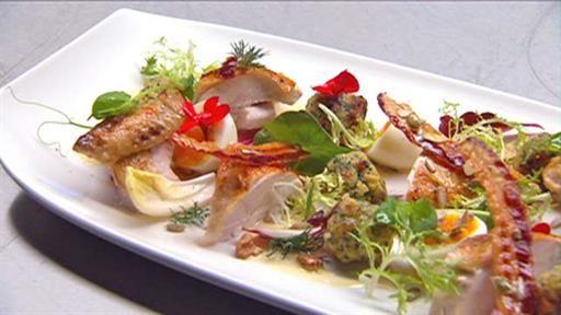 Warm salad of roast chicken, crisp pancetta, soft-boiled egg and bitter leaves