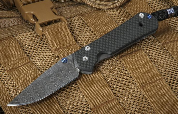 """The Chris Reeve Small Sebenza 21 - Carbon Fiber & Ladder Damascus has a vibrant family history. The original Sebenza knife was developed in 1987 and quickly became the standard for excellence. Twenty-one years later, the Sebenza 21 was released to overwhelming acclaim. Around the world, Chris Reeve Sebenza knives are prized for their performance and unmatchable quality. The Chris Reeve Carbon Fiber Sebenza is lightweight and as solid as they come. The overall length measures 6.875"""" and it…"""