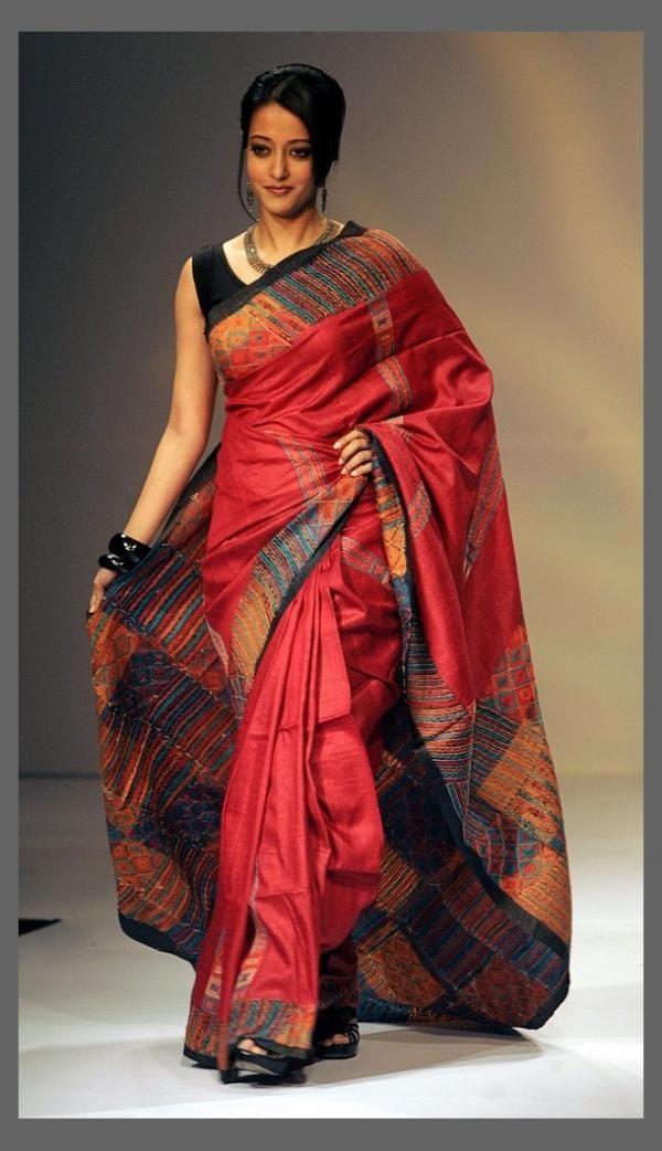 Bollywood actress Raima Sen presents a creation of various local weavers during the Kolkata fashion week April 2, 2009