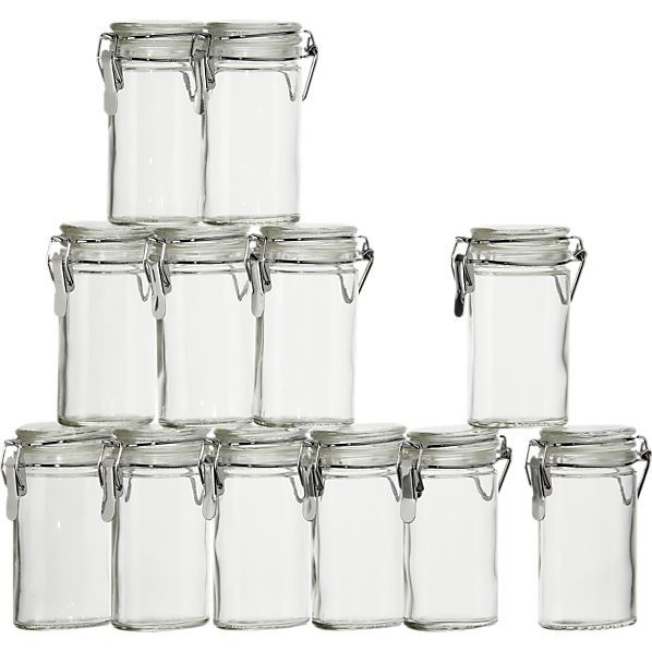 Oval shaped so measuring spoons fit in!  And you can hang them.  Crate & Barrel  Oval Clamp Top Herb Jars