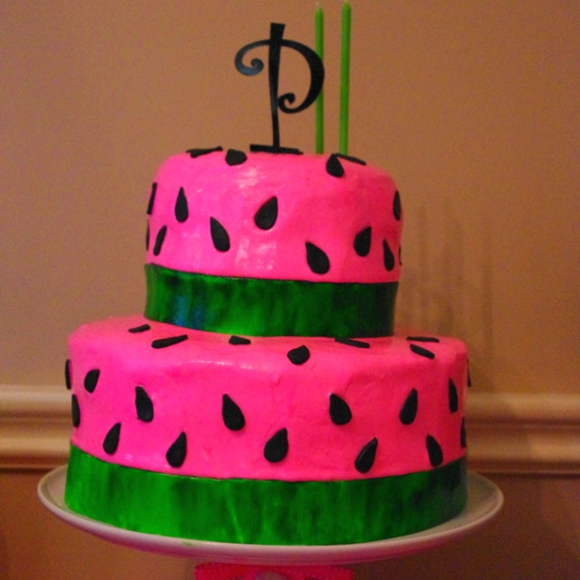 Watermelon birthday cake!    Add a package of watermelon jello to one box white cake mix = delicious!    pink icing, black fondant for the seeds, white icing for the rind (paint it green to get the streaked effect)