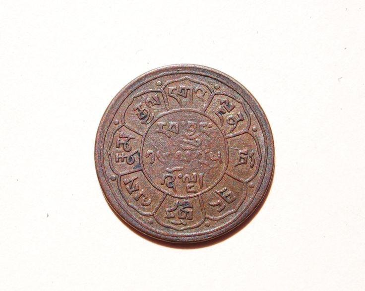 3b. Reverse side of a Tibetan 5 Sho cash coin, ca 1948.