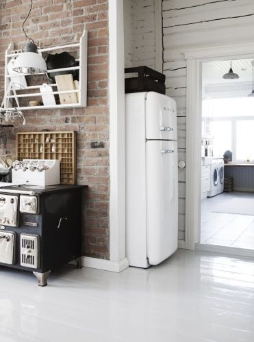 Exposed brick, walls, fridge, fridge nook, light fixture, draftsman's drawer as a shadow box, stove, floor ... Pretty much love all of it.