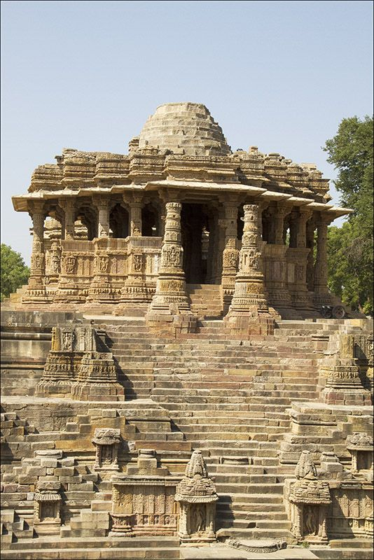 De Sun Temple Modhera, at Modhera in Gujarat_ West India, is a temple dedicated to de Hindu Sun-God, Surya. It was built in 1026 AD by King Bhimdev of de Solanki dynasty. De temple comprises three separate, axially aligned n integrated elements: Surya Kund, Sabha Mandap n Guda Mandap.