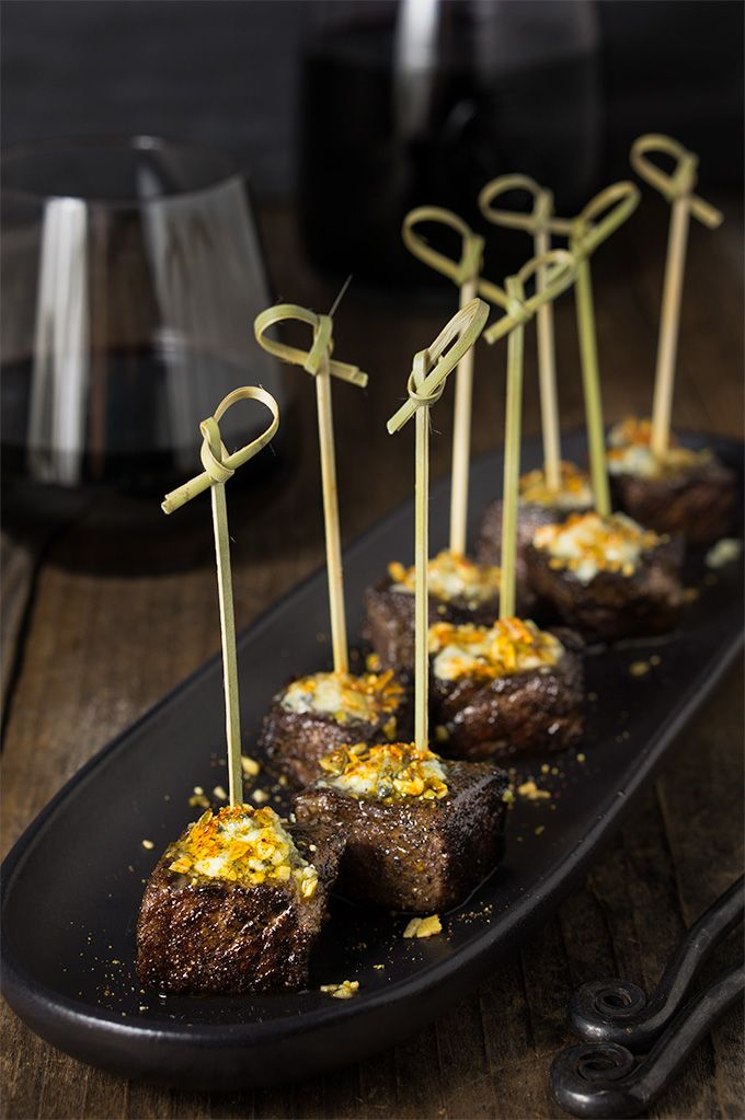 Steak bites with blue cheese butter and smoked pepita crumb - seared to perfection, bursting with flavor, tender steak bites are smeared with melting bluecheese butter, and a crunchy topping of smoked pepitas! | www.viktoriastable.com