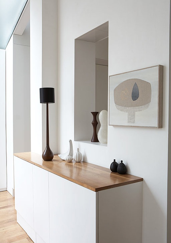 modernize the space by adding clean, minimalist furniture pieces or built-ins that also function as simple storage solutions