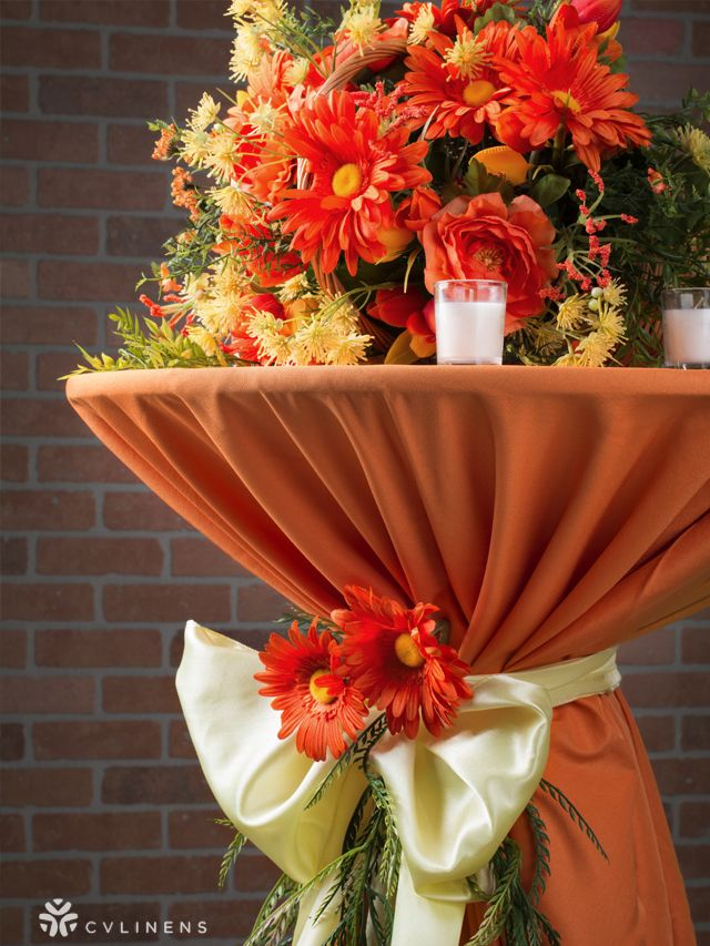 Beautiful Tail Table With Orange Polyester And A Pastel Yellow Chair Sash