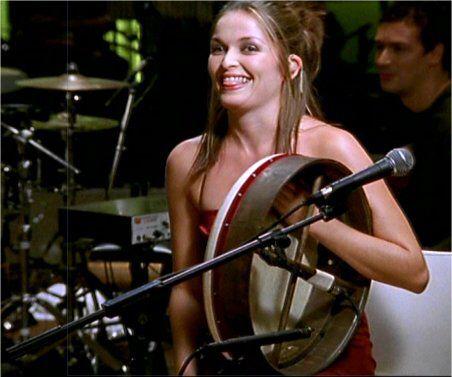 Caroline Corr playing the bodhrán