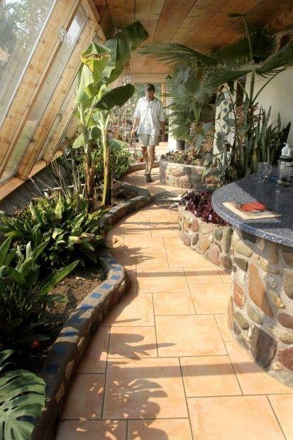 Indoor sun room/walkway/entryway. Could use grey water to keep the plants.
