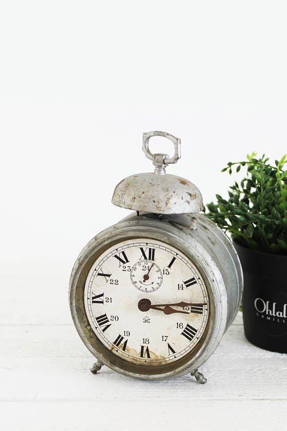 This vintage alarm clock is vintage from France. It has a very industrial charm that would fit great in a rustic clock decor or as part of a clock centerpiece. The clock is, I believe, not in function anymore and therefore can only be used as an amazing piece of decor.  ♥ Want to SAVE 15% OFF your order? Sign up at bit.ly/ohlalavip ♥  - Authentic French vintage - Circa 1900s - Metal alarm clock - Vintage condition: not working, marks and wear of time, rust on the mechanism - Perfect for ...