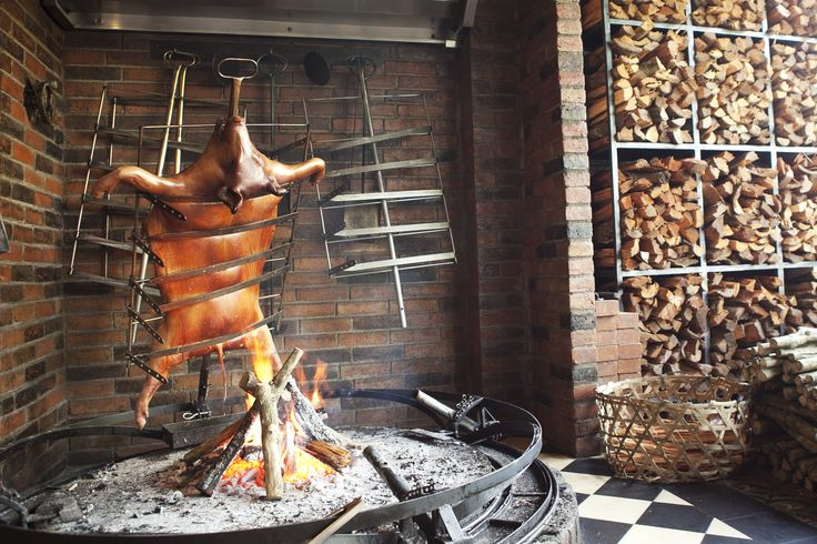 """Arriving at Barbacoa, one of the newest restaurants to open in Petitenget, we find a large golden brown pig being grilled in the open wooden fire, and a cook on standby to constantly add more coffee wood to keep the fire burning. """"It's been slowly grilled for the last eight hours,"""" he explains. Barbacoa 