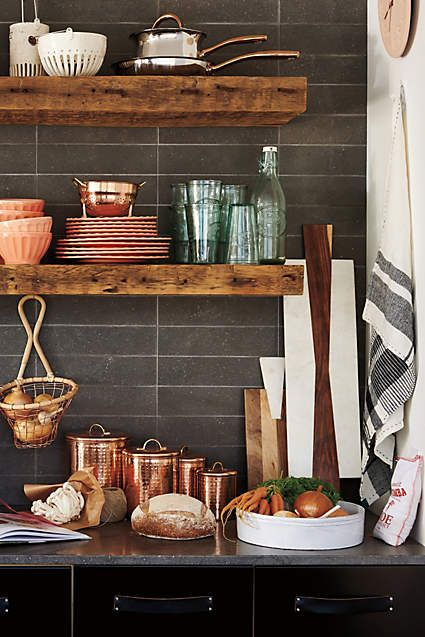 These shelves in front of a pane glass window in kitchen. Copper-Plated Canisters - anthropologie.com