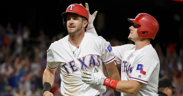 Jared Hoying celebrates with Ryan Rua after scoring in the eighth inning against the Rays at Globe Life Park 5-30-2017. (Smiley N. Pool/The Dallas Morning News)