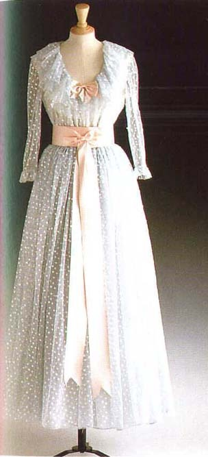 Designed by David and Elizabeth Emanuel, this pale blue tulle ballgown adorned with pearlized sequins with pink sash and bodice bow was first worn by Diana with the Spencer tiara in Australia in 1983. She wore it again on the same tour in Wellington, New Zealand. In 1985 Diana wore this dress to Cardiff, Wales. Lot #23, this gown raised $ 27,600 for Diana's charities.