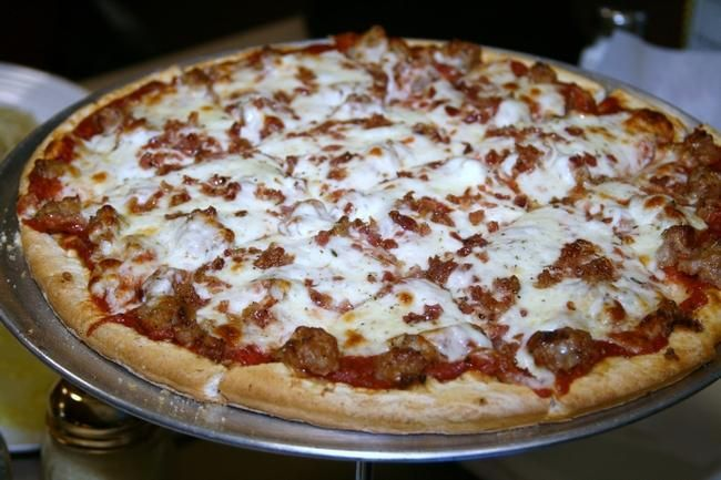 A sausage and bacon pizza is shown from Papa Giovanni's, 1034 Windsor Road, Loves Park.
