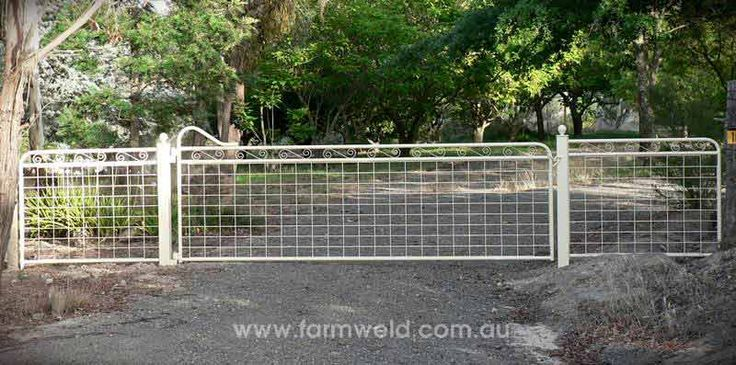 Maddison gate design. The decorative ball cap posts and matching fence panels make this a very attractive rural property entrance. Hall, ACT