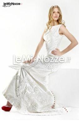 http://www.lemienozze.it/operatori-matrimonio/vestiti_da_sposa/negozio-vestiti-da-sposa-roma/media/foto/24  Abito da sposa con scarpe rosse