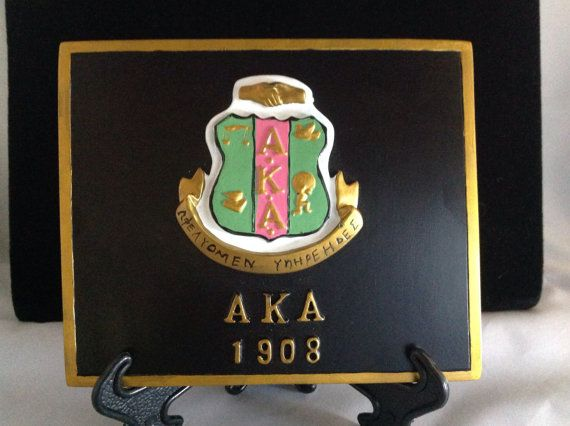 Alpha Kappa Alpha Sorority Crest Plaque. Approx 4x5. Comes with a stand or you can hang it on a wall.