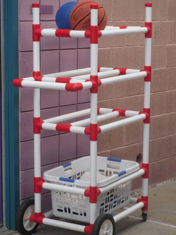 Outdoors toy organizer made from PVC pipe.Roll out the organizer rather than leaving garage door open and kids going in & out.