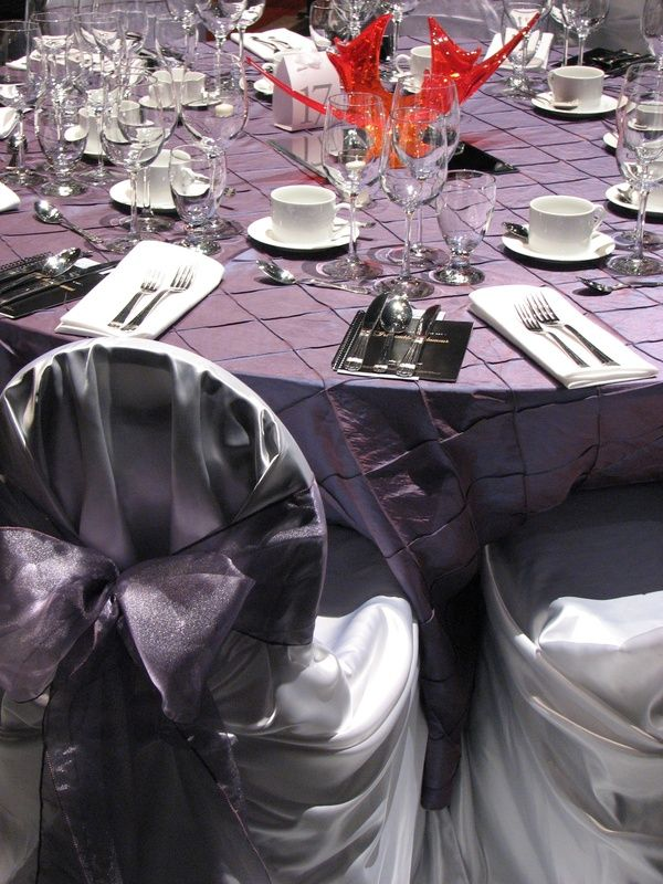 Dinner on the Set fundraiser for Calgary Opera.  Linens used - Antique Violet pintuck floor lenth rounds with white envelope chair covers and Antique violet organza sashes.