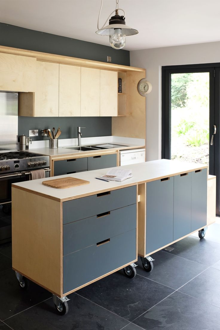 A designer plywood kitchen for a client in penryn. Features a multi functional island unit on castor wheels.