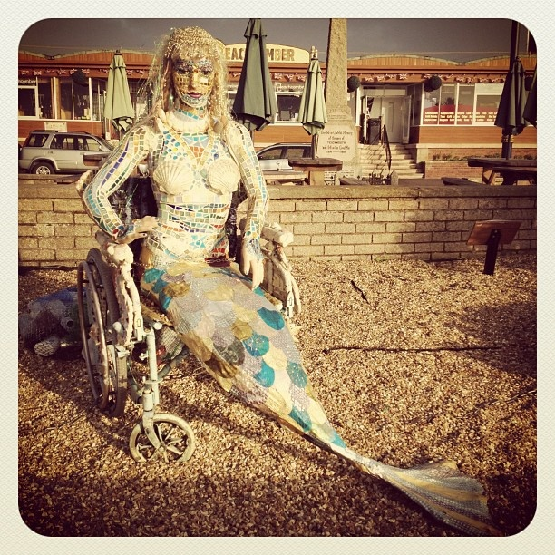 Recycling mermaid in a wheelchair..