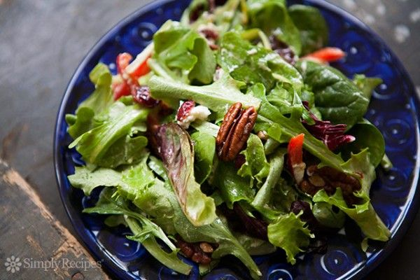 Mixed green salad with pecans, dried cranberries, goat cheese, red bell pepper, and a honey mustard balsamic vinaigrette. ~ SimplyRecipes.com