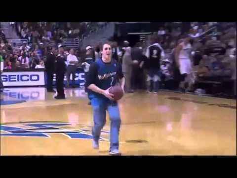 Fan makes a basketball dunk while he's on the phone this is so cool. Watch close to the end.