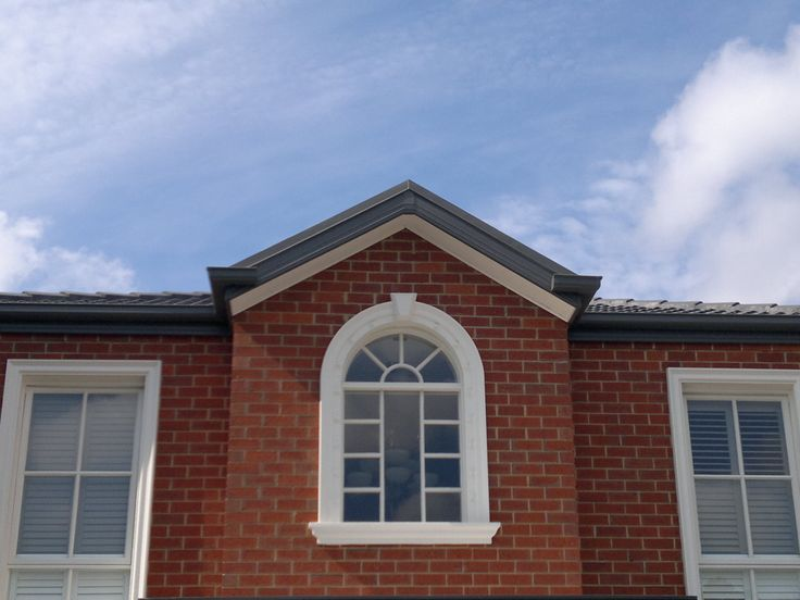 The window mouldings, window sills and keystone add classic style to this home