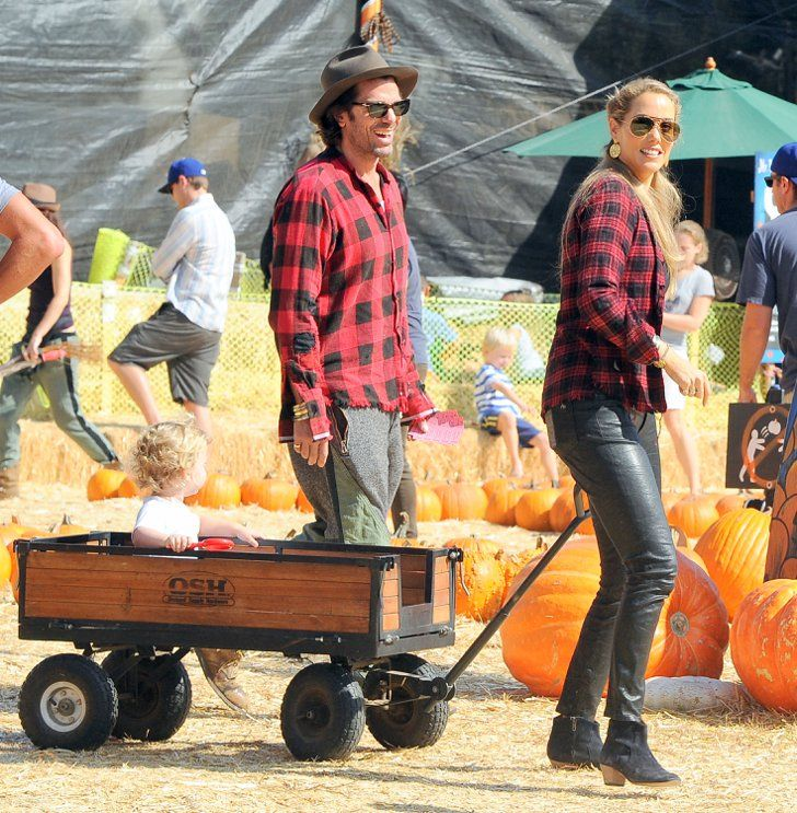 Pin for Later: Stars Share Halloween Family Fun at the Pumpkin Patch  Elizabeth Berkley and her husband Greg Lauren showed Sky the Mr. Bones sights in a wagon.