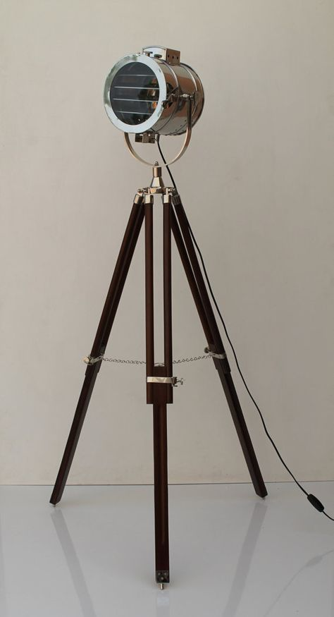 This vintage style designer wooden tripod floor lamp will add a bold statement to your home or office. This photographers tripod floor lamp is used by