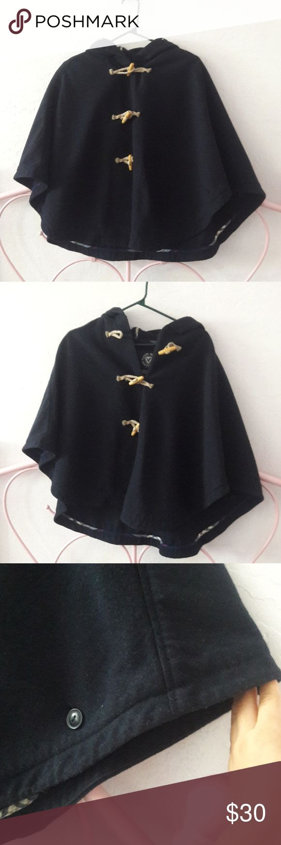 Navy blue cape jacket Navy blue cape jacket. Has a hood, and can be buttoned to have sleeves American Eagle Outfitters Jackets & Coats