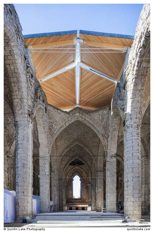 Like an umbrella over. St.Nicolai church, Visby in Gotland, Sweden. originally built in 1230 and is being adapted into a concert hall. Architect:  Exners Tegnestue A/S,  Engineer: Søren Jensen