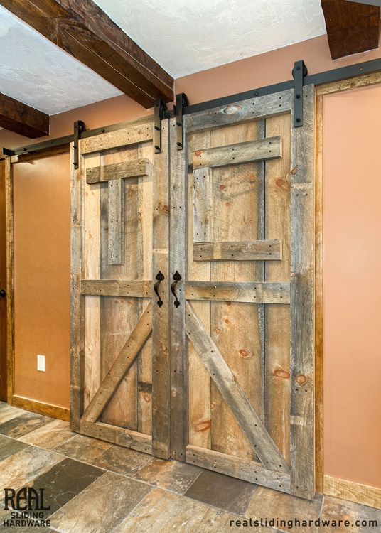 These Monogrammed Barn Doors Were Used With Barn Door Hardware To Separate  The Kitchen From The Dining Room.