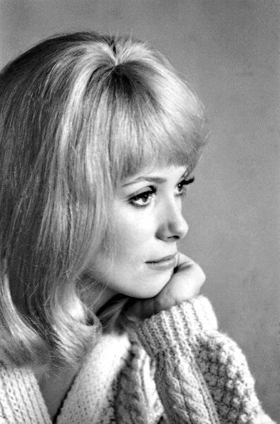 Catherine Deneuve on the set of 'Les Demoiselles de Rochefort' in 1966.