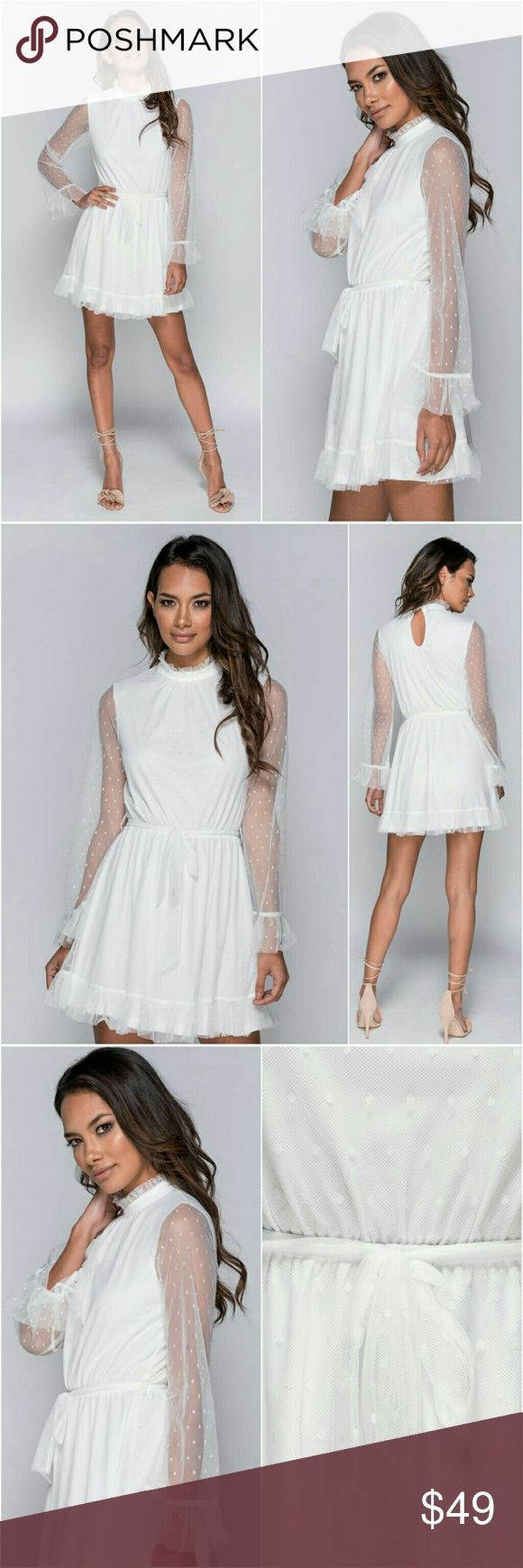 Parisian White Sheer Sleeve Polka Dot Mini Dress Ruffles are in this Fashion 2018 Season! This Parisian Dress has it all! Gorgeous lined, Frilly white sheer polka dot, long sleeves, with tie belt! Oh yes, those modestly ruffled cuffs & hem give this Stunning Mini Dress all the right touches! Sizes converted from UK Chart to US Sizes. Viva Nashville Boutique Dresses Mini