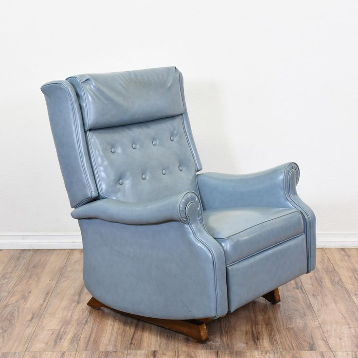 This mid century modern rocking armchair is upholstered in a durable glossy light blue vinyl fabric. This retro recliner is in good condition with a tall tufted back, curved arms and rocking base with reclining back and footrest, Stylish and unique chair perfect for lounging! #midcenturymodern #chairs #recliner #sandiegovintage #vintagefurniture