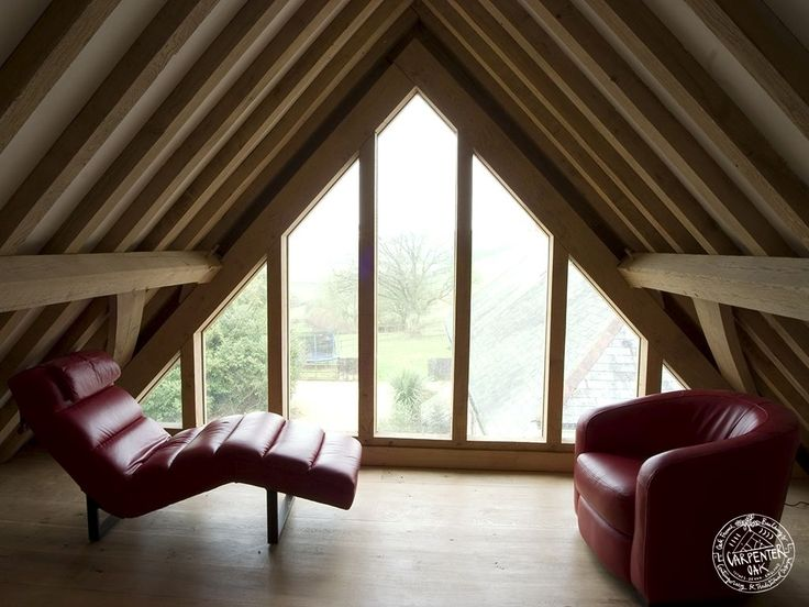 Timber frame loft conversion with glazed gable end by Carpenter Oak Ltd.