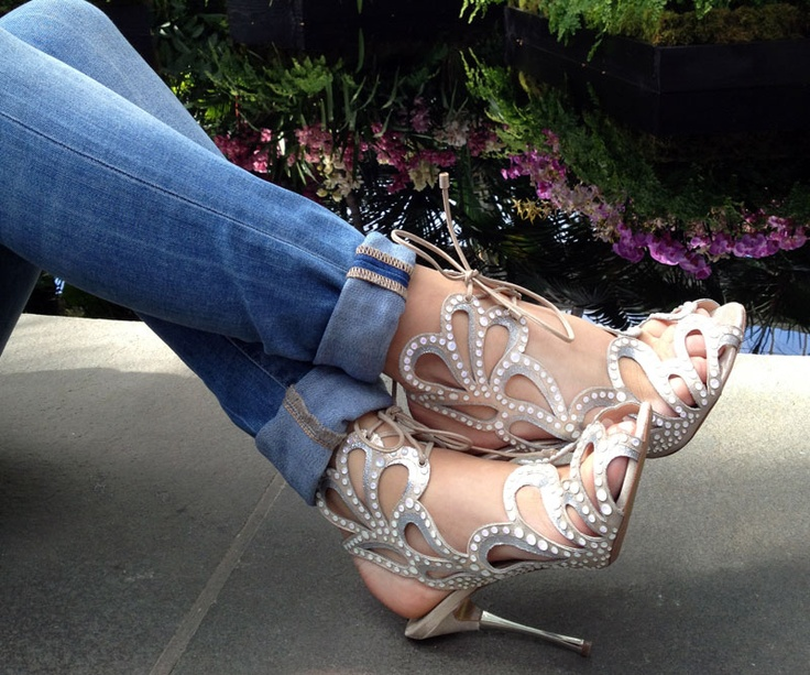 Another way to dress up your denim: pair them with over-the-top stilettos. Like these Nicholas Kirkwood gladiators.