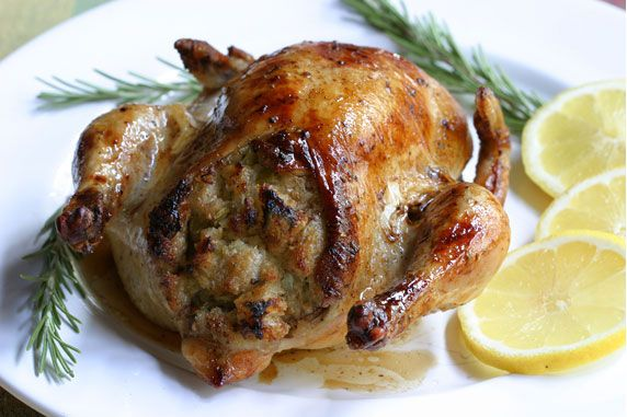Cornish game hens baked with a rosemary and sage stuffing and basted with a rosemary, lemon and butter sauce. Also can be used with chicken.