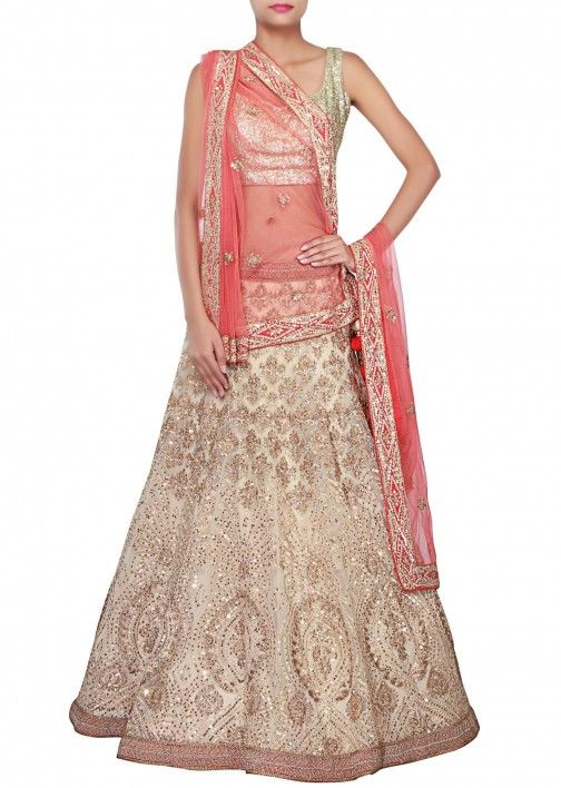 Beige and peach lehenga adorn in thread and sequin embroidery only on Kalki
