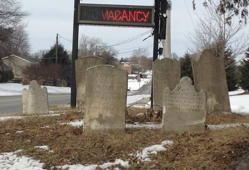"""Siegrist Cemetery, Ronks PA, alongside the sign for the """"Quiet Haven"""" Motel Photo credit: Julie Sterner"""