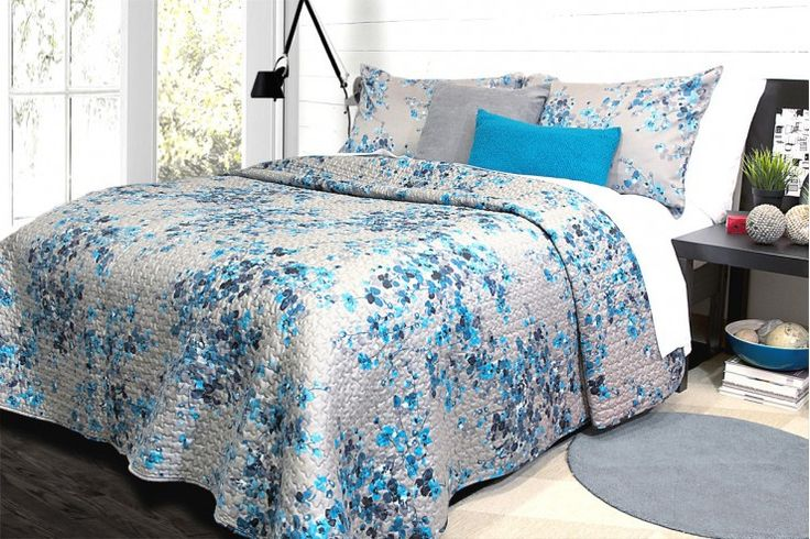 """A detailed approach to workmanship and enduring style are the primary considerations given to the creation of Hycroft. Its embroidered blooms in Maya blue on a charcoal backdrop have a floating quality that is both fragile yet cultivated!100% Cotton sateen220 Thread countReversible printStandard and King pillow shams are sold in pairsShown with Spun Silk 24"""" and Bouclé peacock 12x20"""""""