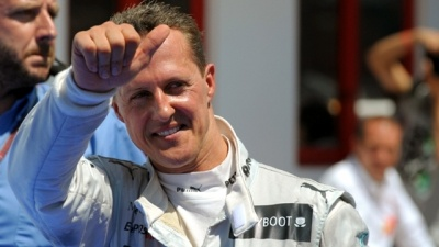 Mercedes' driver Michael Schumacher celebrates in parc ferme at the Valencia Street Circuit on June 24, 2012 in Valencia after taking third place of the European Formula One Grand Prix