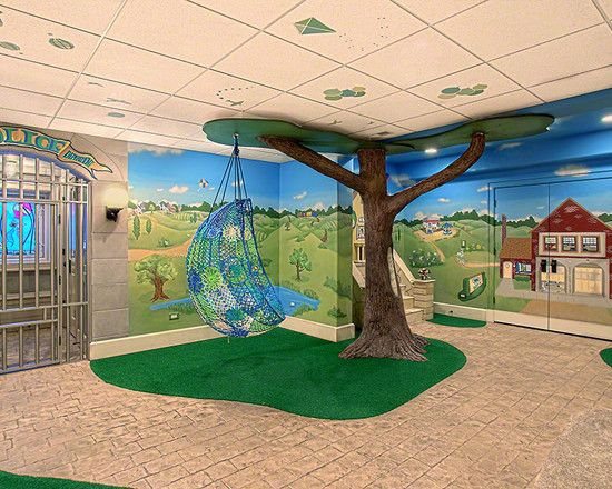 basement playroom design with nature wall paint and tree ornament