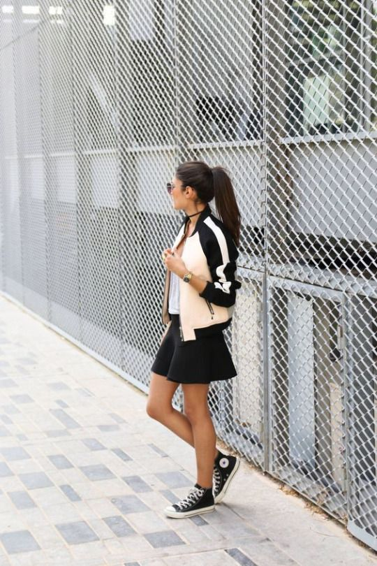 Converse and a bomber jacket is the perfect combination for a truly retro fifties style! This all-American style varsity bomber is a throwback item, and looks great worn with a cute black mini skirt and classic black Chuck Taylor's. Via Federica L. Bomber: Mango, Skirt: Zara, Shoes: Converse.