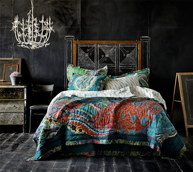 anthropologie bedroom with chalkboard walls and colorful bedding