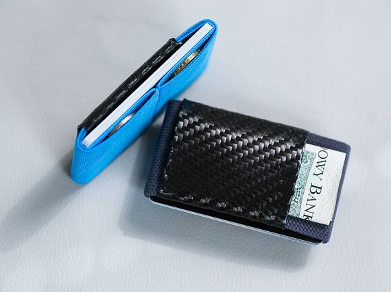 Throw away your old, bulky wallet and order a slim, elegant rubber and carbon fiber wallet from Elephant Wallet today! This minimalist wallet has an impressively simple design that incorporates a rubber strap and soft carbon fiber to produce a super slim wallet that functions as a credit card holder and business card holder while still having room to keep cash, coins and a memory card safe and in one place. Keep it in your pocket or put it inside your briefcase or purse as a bag organizer…