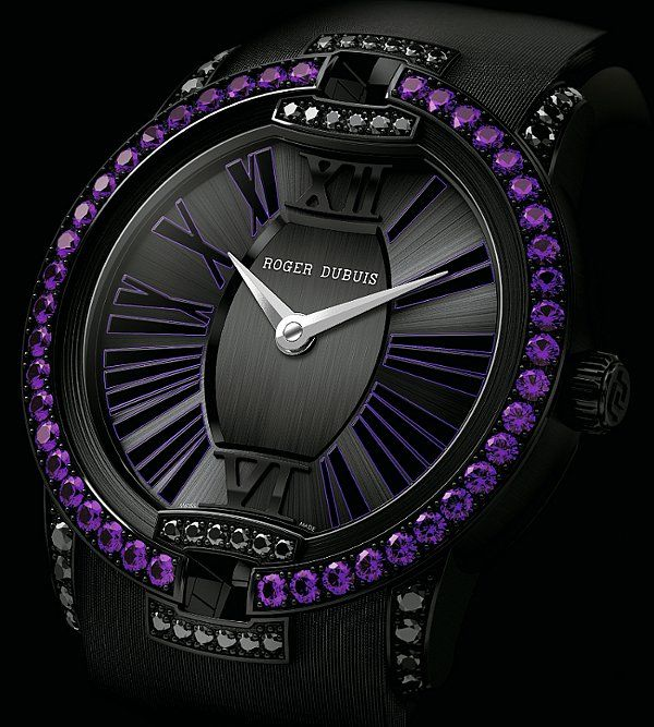 Roger Dubuis Velvet: Amethysts and Spinels | The combination of purple amethysts on the black bezel works so well on this ladies' watch from the Velvet collection. The Velvet collection provides classy time-keeping for ladies, featuring a stunning bezel defined by the 46 amethysts that adorn it. The blend of black and purple simply oozes elegance every time you glance down at it, and the black satin strap provides an extra high class touch.